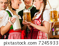 Young people in traditional Bavarian Tracht in restaurant or pub 7245933