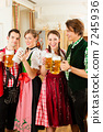 Young people in traditional Bavarian Tracht in restaurant or pub 7245936