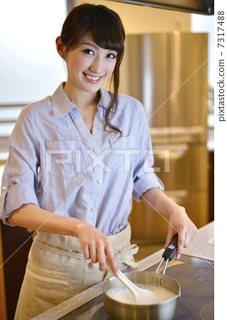 Young lady cooking 7317488