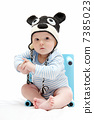 beautiful baby boy with knitted hat sitting 7385023