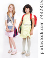 School children with bags and books, isolated 7432315
