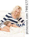 happy mother and sleeping girl 7449177
