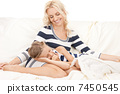 happy mother and sleeping girl 7450545