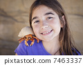 Young Girl Playing with Toy Hermit Crab 7463337