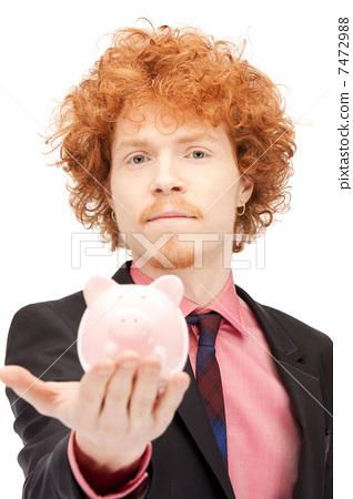 man with piggy bank 7472988