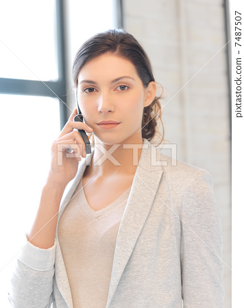 businesswoman with cell phone 7487507
