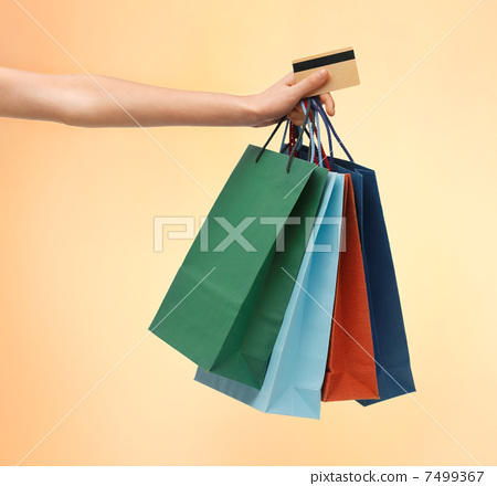 multi colored shopping bags and credit card 7499367