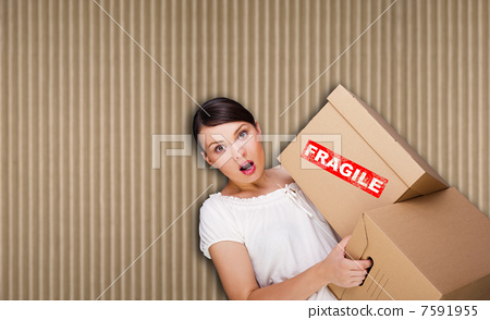Closeup portrait of a young woman with boxes 7591955