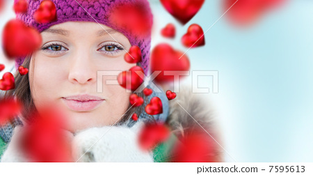 Happy girl thinking of love and having fun outdoors in winter 7595613