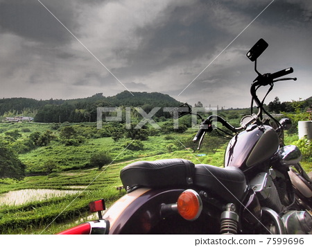 Motorcycles and rice terraces 7599696