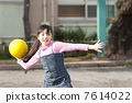 Elementary school girls playing dodgeball 7614022