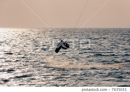 Kite surfer jumping from the water 7635031