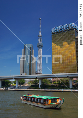 Tokyo Sky Tree and Houseboat in Sumida River 7697555