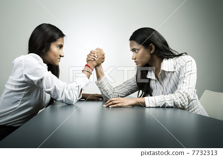 Business co-workers arm wrestling for control. 7732313