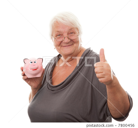 Portrait of a happy mature woman holding piggy bank isolated aga 7800456