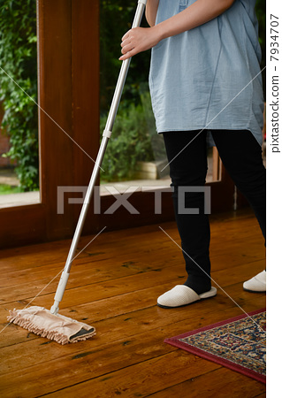 Stock Photo: sweeping the floor, cleaning the floor, housework