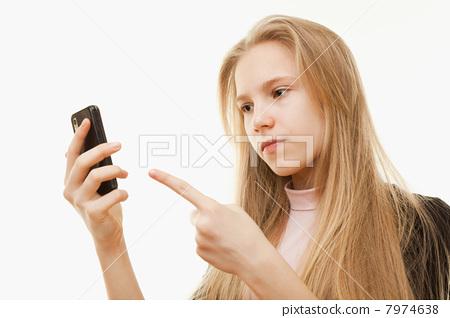 Teenager girl and mobile phone 7974638