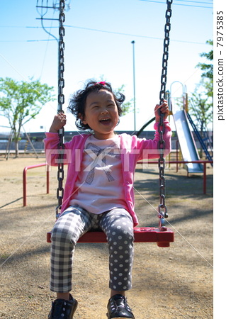 A girl playing with a swing 7975385