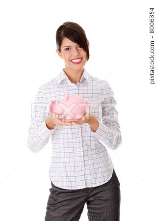Businesswoman holding piggy bank 8006354