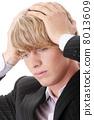 Businessman with a big headache 8013609