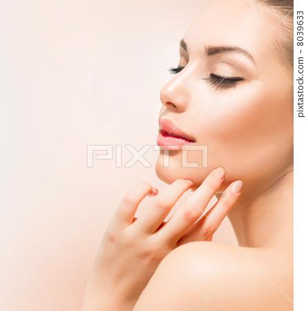 Stock Photo: Spa Girl. Beautiful Young Woman Touching Her Face