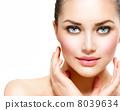 Beauty Portrait. Beautiful Spa Woman Touching her Face 8039634