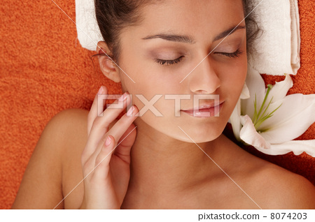 Girl with olive skin at spa 8074203