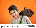Young boy with baseball glove and bat 8079087