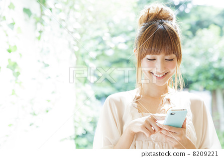 A woman relaxing on the terrace 8209221