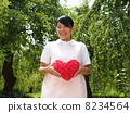Medical apron woman and red heart 8234564
