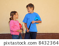 Brother and sister with yo-yo toy look at each other and laugh o 8432364