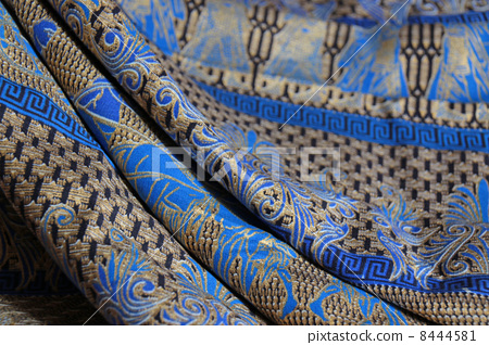蠟染民間工藝品巴厘島印尼東南亞亞洲商品布料棉花棉印花金色藍色紀念品圖案異國背景背景紡織紡織傳統部落馬來西亞熱帶國家 8444581