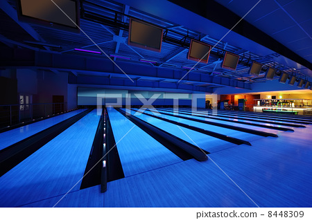 Empty bowling club, lot of bowling lanes with skittles, blue lig 8448309