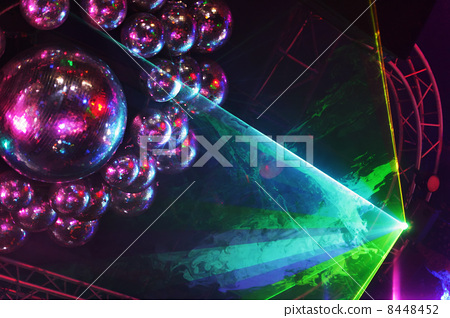 Beautiful shiny balls and colorful rays on ceiling in night club 8448452