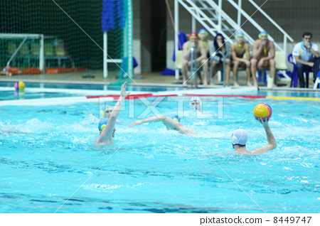 MOSCOW - MARCH 3: Men play water polo in pool, spectators, judge 8449747