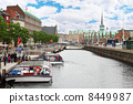 Small vessels in channel, building of Stock Exchange in Copenhag 8449987