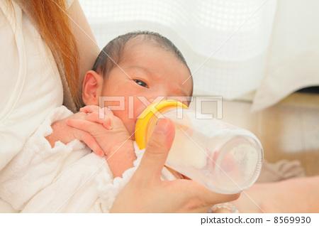 Baby drinking milk 8569930