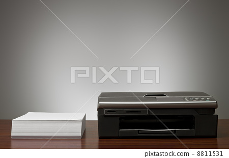 Copy Machine and a pile of papers 8811531