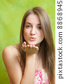 Air-kissing long-haired teen girl 8868945
