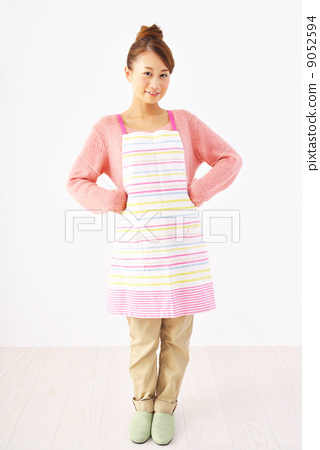 A woman in an apron 9052594