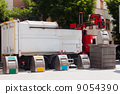 Garbage truck collects garbage dumpster 9054390