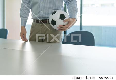 A man with a soccer ball 9079943