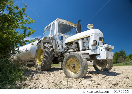 lonely white tractor 9172355