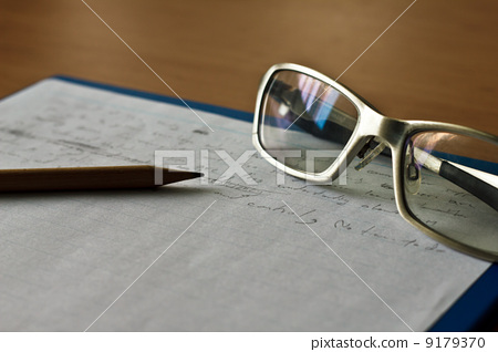 pencil, notebook and glasses 9179370