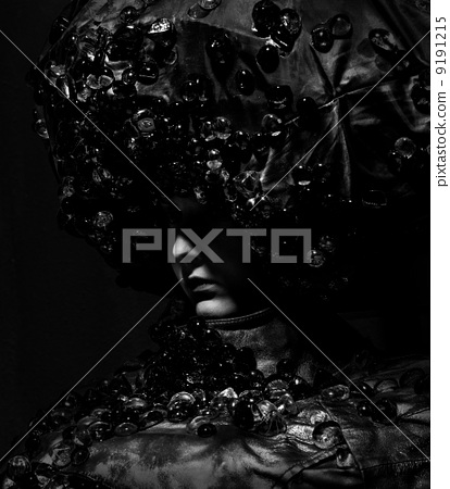 fashion qeen woman face on dark background 9191215