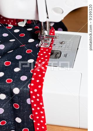sewing dress on machine 9199120