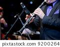 musician plays on clarinet 9200264