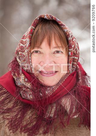 portrait of mature woman in babushka 9209766