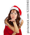 Air-kissing girl in christmas costume 9209940