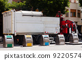 Recycling truck picking up bin 9220574
